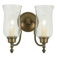 Two light upward sconce with hurricane glass